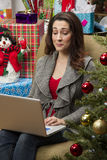 Woman shopping online for Christmas presents. Stock Photo