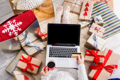 Woman shopping online with a credit card Stock Images