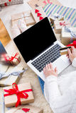 Woman shopping online with a credit card Stock Photography