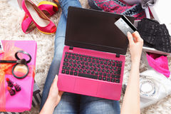 Woman shopping online with a credit card Stock Photos
