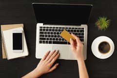 Woman`s typing hands on laptop top view royalty free stock images