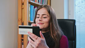 Woman Shopping Online with Credit Card Using Phone stock footage