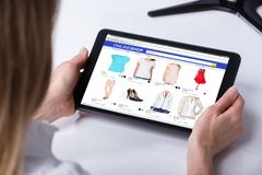 Woman Shopping Online On Digital Tablet royalty free stock image