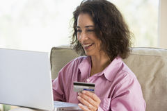 Woman shopping online at home. With credit card Royalty Free Stock Photo