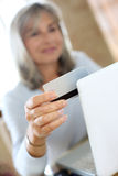Woman shopping online from home Royalty Free Stock Photo