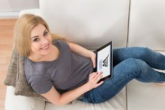 Woman Shopping Online At Home. Young Happy Woman On Sofa Shopping Online With Digital Tablet At Home Stock Image