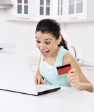 Woman shopping online at home Stock Images