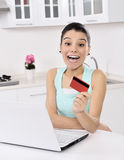 Woman shopping online at home Royalty Free Stock Photography