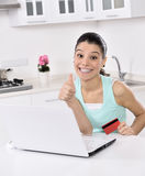 Woman shopping online at home Stock Photos