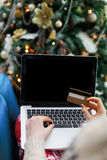 Woman shopping online on laptop with cradit card Royalty Free Stock Images