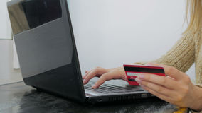 Woman shopping online at laptop with credit card Royalty Free Stock Photography