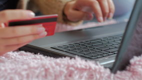 Woman shopping online at laptop with credit card stock video footage