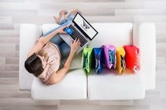 Woman Shopping Online On Laptop stock photos