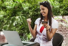 Woman shopping online and making a fist Royalty Free Stock Images