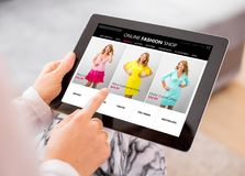 Woman shopping online for new dress. Es Royalty Free Stock Images