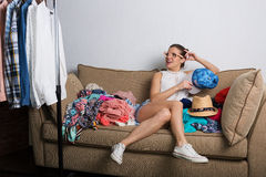 Woman shopping online. Shopaholic hipster woman at home sorting her wardrobe Stock Photo