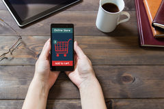 A woman is shopping at the online store. Cart icon. Ecommerce. Stock Photo