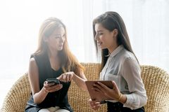 Woman Shopping Online. Two Business Woman Shopping Online by Smartphone or Tablet Pay by Cradit Card Royalty Free Stock Photo