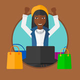 Woman shopping online using her laptop. Stock Photo
