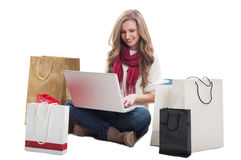 Woman shopping online using laptop Royalty Free Stock Photos