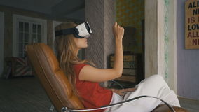 Woman shopping online by VR headset glasses of virtual reality at home