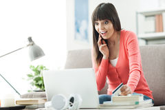 Woman shopping online Stock Image
