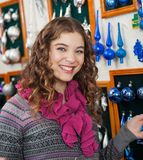 Woman Shopping Ornaments In Christmas Store Royalty Free Stock Image