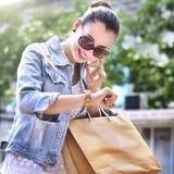 Woman Shopping Outdoor Talking Mobile Phone Concept Royalty Free Stock Photos
