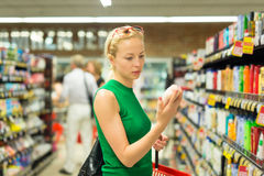 Woman shopping personal hygiene products at supermarket. Royalty Free Stock Photos
