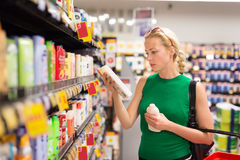 Woman shopping personal hygiene products at supermarket. Royalty Free Stock Images