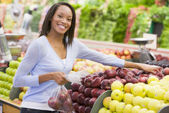 Woman shopping in produce department. Of supermarket Stock Image