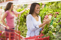 Woman shopping in produce section. Of supermarket Royalty Free Stock Images