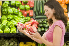 Woman shopping in produce section Royalty Free Stock Image