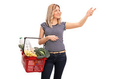 Woman shopping and reaching for something Stock Images