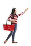 Woman shopping and reaching for something Royalty Free Stock Images