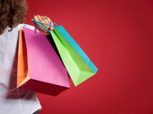 Woman shopping in red background Royalty Free Stock Image