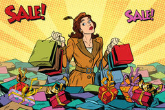 Woman with shopping in a sea of sales Stock Photography
