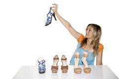 Woman shopping for shoes Stock Photos