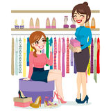 Woman Shopping Shoes. Beautiful young woman trying and shopping different shoes with help from shoe store assistant Stock Photography