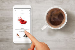 Woman shopping shoes with smart phone Royalty Free Stock Photo