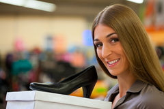 Woman shopping shoes in store Royalty Free Stock Photo