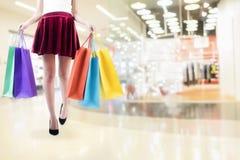 Woman shopping in shopping mall. Woman shopping in shopping mall and carrying shopping bags Stock Photography