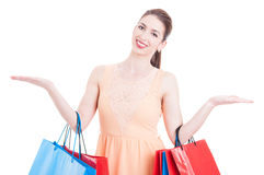 Woman at shopping showing copy space area with both hands Stock Photos