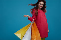 Free Woman Shopping. Smiling Beautiful Fashion Model With Paper Bags Royalty Free Stock Image - 80396826