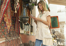 Woman Shopping At Souvenir Stall Stock Photos