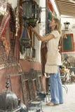 Woman Shopping At Souvenir Stall Stock Photo