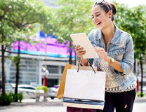 Woman Shopping Spending Customer Consumerism Concept. A woman is enjoy shopping Stock Image