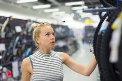 Woman shopping sports equipment in sportswear store. Stock Photo