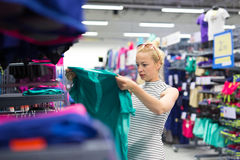 Woman shopping sportswear in sports store. Royalty Free Stock Photo