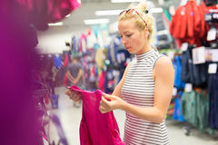 Woman shopping sportswear in sports store. Stock Image